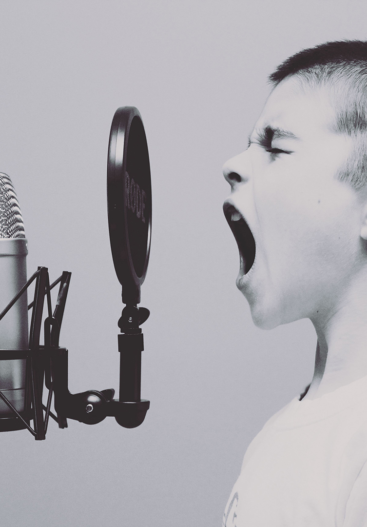 child screaming into microphone