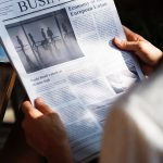 reading business paper